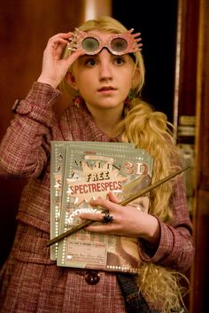 Harry Potter and the Half-Blood Prince: Luna Lovegood finds Harry in his Invisibility Cloak in the Platform 9 3/4 Express Train.