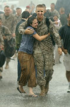 I took this photo at the Marine Corps Air Station in Beaufort, South Carolina, as a group of U.S. Marines were returning home from the war in Iraq. As soon as they arrived, it began to downpour.  I was lucky enough to capture the joy they were all feeling. The two people walking and embracing are brother and sister. This was such a wonderful moment for everyone, and I'm so happy I was able to capture it for them!