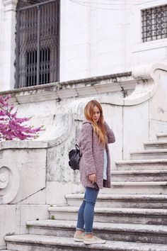 Wearing a knitted pink coat, skinny jeans, denim shirt, leather backpack and Superga sneakers - teetharejade.com
