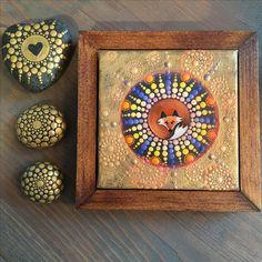 Original fox mandala painting with gold overlay. Shown with mandala stones.