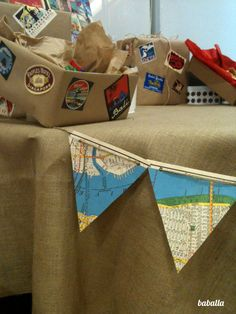 kraft paper wrapped boxes, stickers and twine make perfect decor elements for a bon voyage party!