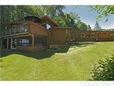 780 Tonkawa Road, Orono, MN 55356 Custom built prairie-style home designed by John Howe. Frank Lloyd Wright style. African Mahogany throughout. On prestigious Tonkawa Road in Orono & adjacent to large heavily wooded outlot-very private w/ amazing views. 2-2 car garages, 3 bed on one level