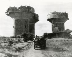 These three enormous flak towers guarded a German Marine base near Angers, France. Each tower would have been armed with several large caliber and small caliber anti-aircraft guns, including the much feared 88 mm Flak gun. The towers were destroyed by Allied air attacks as General Patton's 3rd Army advanced East.