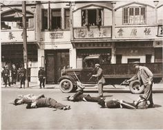 Shanghai policeman executing communists agents before the city fell to Chinese communist troops. May 16, 1949
