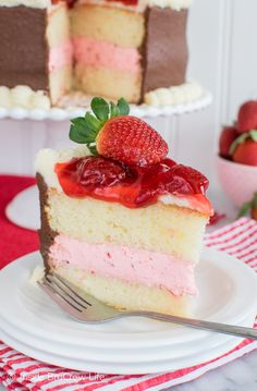 Layers of vanilla cake, strawberry pie filling, and chocolate frosting make this Strawberry Mousse Cake a delicious and pretty treat.