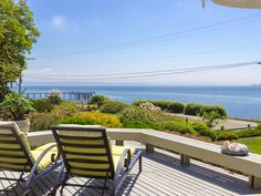 Island Retreat on South Beach on Bainbridge Island, WA   This timeless waterfront retreat is one of the sunny south end's most admired homes. Perched atop tiered lawn and gardens, generous deck offers sweeping views of Mt. Rainier.