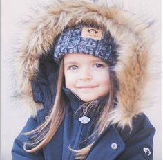 This cutie in an Appaman winter kids hat is beyond adorbs. Loving the cool beanie hat for kids with a fur hood jacket. For more winter hats for kids and winter coats for kids, check out appaman.com.