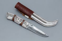 Knife by: P-O Eklund Materials: mosaic damascus, antler, birch burl, leather.