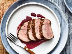 This Pork Tenderloin with Roasted Strawberry–Merlot Sauce recipe gets its flavor from coriander seeds, shallots, and dry red wine. Get the recipe from Food & Wine. Sauce For Pork Tenderloin, Pork Tenderloin Recipes, Pork Recipes, Wine Recipes, Cooking Recipes, Meal Recipes, Pork Roast, Sauce Recipes, Gourmet