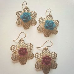 "FLASH SALE  Filigree Earrings with Rose Embellishment  retail price $44. FLASH SALE price $18  TO BUY: Comment with your email address and you'll receive a secure checkout link.  Options: red rose: $15.00 turquoise rose: $15.00. Earrings are 1"" in diameter. 14K gold dipped ear wires gold tone filigree. 	These are one-of-a-kind. Only 1 pair available in red and one pair available in turquoise  Promote our products and earn same day commissions: spree.to/?u=1bqa Direct link…"