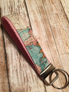 Filling a custom order for 30 passport covers today check out our world map world globe key fob world map key chain gumiabroncs Gallery