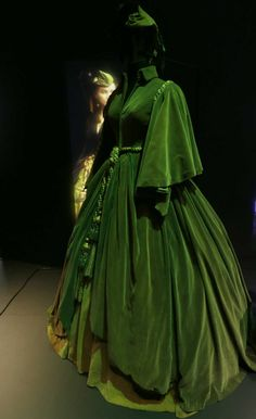 A costume worn by British actress Vivien Leigh as Scarlett O'Hara in the iconic 1939 movie 'Gone with the Wind' on display at the Hollywood Costume exhibition...