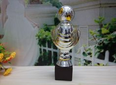This Football trophies, soccer awards, sports trophies made out of ceramic with silver and gold coating feature a footbal on a sport suit. This item could be a nice reward to encourage football player in any football events. The item number is MD11284 Our email is sale1@hpceramics.com web: www.hpceramics.com