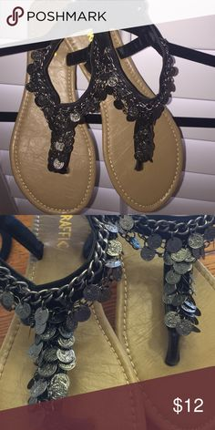 New without tags..Embellished Sandals Cute black thong sandals with pewter toned chain and coin embellishments.  Traffic brand. Never worn but don't have box. Traffic Shoes Sandals