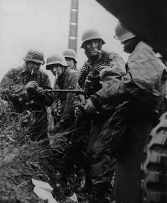 Soldiers from Kampfgruppe Hansen (Leibstandarte Division) take a cigarette brake. Such a state was the norm during combat operations. This photograph was taken after the action with American 14th Cavalry Group on the road between Poteau and Recht during the Ardennes Offensive, 18 December 1944.
