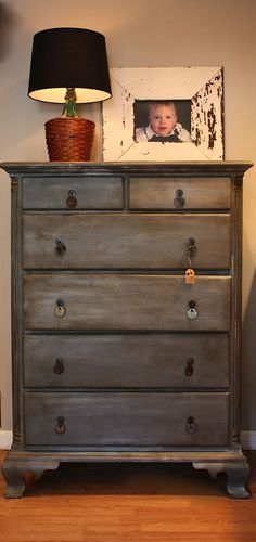 DIY Zinc faux finish on a dresser using dark grey paint, silver metalic craft paint, and Annie Sloan dark wax.