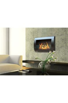Ventless- no need for a chimney Easy to mount on your wall Burns indoors cleanly with no soot, smoke, ash or toxins Easily create a warm and inviting atmosphere Anywhere in your home ONLY USE Liquid bio-ethanol fuel made for fireplaces Ethanol Fireplace, Wall, Wall Mount Fireplace, Home Decor Styles, Wall Mount, Black Walls, Contemporary Fireplace, Contemporary, Fireplace