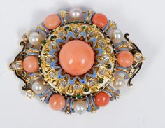 Victorian Renaissance-style yellow metal brooch set with  coral, cultured pearls, diamonds and tiny cabochon green garnets