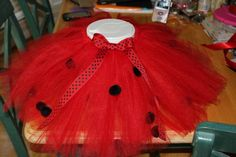 I made this tutu.. used black pom poms made a super cute lady bug costume!