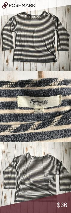 Madewell gray and cream striped long sleeve top Madewell gray and cream striped long sleeve top. Size medium. 100% cotton. A cream shirt with dark gray stripes. No trades, offers welcome! Madewell Tops