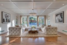 Traditional Living Room with Box ceiling, Chandelier, French doors, Wainscoting, Robert Abbey Bling Large Chandelier
