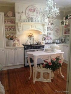 Shabby Chic Kitchen with a Small Pink Island in Center.