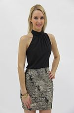 This is a lovely one shoulder turtle neck mini dress. The standout feature of this dress is the lower section, which is a golden print series of dots. It is shiny and sparkly through out. At the back you'll find a slat across, as well as a collar bow-style drape. Pair with a lovely golden bracelet.Details:- Polyester, Spandex- Hand Wash Cold- Made in USA