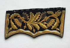 Dutch gold embroidery.