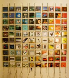 CD cases. You could use actual album art, or photos or scrapbook paper. It's nice how color gradation was employed.