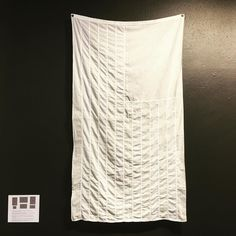 """Whitewashed"" by @hballardmartz in current exhibition ""What Would Betsy Ross Do?"" Vintage US flag and chemical color remover. ""In the wake of the 2016 presidential election there is a sense that xenophobia bigotry and racism have been given the stamp of approval by the new administration."" #whatwouldbetsyrossdo #communityarts #flag #newusflag #resist #hollyballardmartz #activistart"
