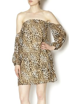 Lined leopard off the shoulder dress. This dress would look cute with boots or your favorite wedges. Leopard Dress by Turquoise Haven. Clothing - Dresses - Long Sleeve Clothing - Dresses - Printed Clothing - Dresses - Night Out Clothing - Dresses - Mini Palm Beach, Florida
