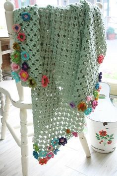 Add some crochet flower motifs to the edges of your blanket pattern for a fun look