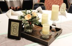 Table arrangement vignette with peach and blue green tones, *Creative Touches Evansville*
