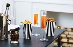 Just as you'd wear denim with diamonds, serve your popcorn with champagne. A bottle of bubbly is way less involved than a mixologist-approved cocktail, meaning you'll spend less time prepping and more time sipping.