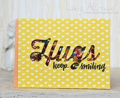 """Keep Smiling by Lucy Abrams—""""Instead of the usual shaker, I actually added a load of Multi Matte Medium to the background paper, then added my shaker material all over it, pressing it down so it stuck to the paper. Instead of all the shaker contents hiding at the bottom of the card, they fill it. And I added some extra before sealing it up to make sure it still shakes!"""""""