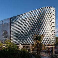 A parking garage in the Miami design district features a textured facade of perforated metal panels. Read more and see the pictures from @dezeen. #Design #Miami #Metal