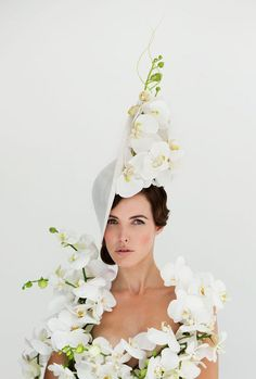Leave your hat on  Philip Treacy collection inspired by orchids and  modelled in the nude f6f8089b853