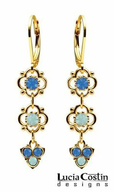 Dangle Floral Earrings Designed by Lucia Costin with 4 Petal Flowers, Blue and Mint Blue Swarovski Crystals, Ornate with Fancy Charms; .925 Sterling Silver Plated with 14K Yellow Gold Lucia Costin. $39.00. Unique jewelry handmade in USA. Splendid combination of dangle elements. Update your everyday style with inspiration when wearing this piece of jewelry. Dangle earrings beautifully designed by Lucia Costin. Beautifully designed with pacific opal and sapphire Swar...