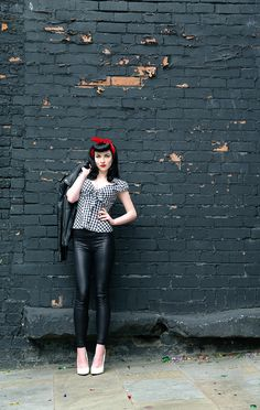 Rockabilly. Love the leather moto jacket, gingham top, and white heels.