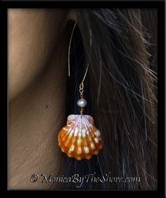 An amazing pair of pristine perfect Hawaiian Sunrise Shells in bright orange with pure white flecks! Each shell is a top shell with beautiful bumpy ribs and fine detail, and dangle from a stack of Swarovski Crystals and white cultured Pearls, on 18K gold filled long wire earrings. Each shell is 7/8 inch in size, total dangle length is slightly less than 3 inches long. Fabulous jewelry! Designer Hawaiian Sunrise Shells jewelry custom designs by MonicaByTheShore of Haleiwa, Hawaii.