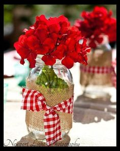 Cute roses in mason jar wrapped in burlap