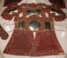 Chilta hazar masha (coat of a thousand nails), bazu band (arm guards). Indian armored clothing made from layers of fabric faced with velvet and studded with numerous small brass nails, which were often gilded. Fabric armor was very popular in India because metal became very hot under the Indian sun. This example has additional armor plates in the chest and arms. Powis Castle.