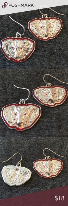 """Pierced Earrings Elephant Head with red trim Pierced Earrings Elephant Head with red trim.  Elephant has red eyes.  Silver tone.  Never been worn.   1"""" wide by x 7/8"""" tall.  Dangle.  Also have a Necklace that matches Jewelry Earrings"""