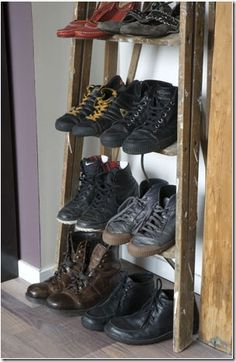 Use a ladder as a shoe rack, for the family. This might actually work.  Woo Hoo
