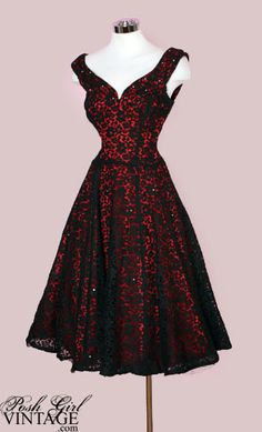 This elegant vintage 50's evening dress is just stunning! Rich red satin with a sheer black lace overlay that's sprinkled with crystal rhinestones.
