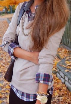 V-neck sweaters and plaid blouses layering each other. It is a perfect combination to either dress up or dress down.