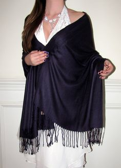 "This Dark Purple Pashmina Stole Shawl/Stole/Wrap is a beauty and great as a bridal wedding & bridesmaids shawl. This Discounted Elegant Purple Pashmina Shawl is a best buy. This pashmina &  silk is a popular size at 28"" x 76"". Hence can be draped as a stole or used as a long scarf. Great buy at this deeply discounted pricing. Our ""How to wear a Pashmina"" section gives you different styles of wearing a Pashmina. Click here."