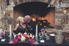 The fireplace in the Presidential Hall is great for winter weddings at the Mountain View Grand Resort and Spa!  Photography by Hart Photo's.