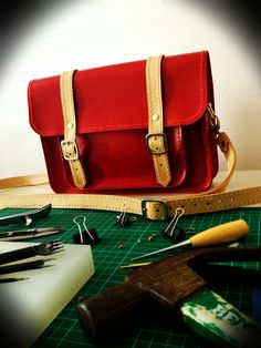 Hand-Stitched Leather Satchel in Vivid Red with natural tan strap.   https://www.etsy.com/uk/shop/HideAndStitches
