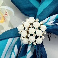 This flower scarf features the vivid design of camellia flower cluster with trio holders which is used to fasten the scarf or curtain. Scarf Holder, White Camellia, Scarf Rings, Gold Rhinestone, Gold Rings, Bouquet, Silk, Rose, Birthday